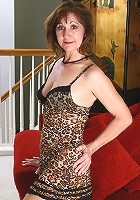 Done up in lace 51 year old Lynn spreads her legs wide for the camera