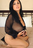 Busty 35 year old Jaylene from AllOver30 wearing hot black lingerie