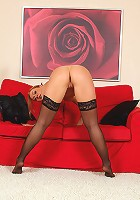 Spicy 31 year olf Roxy R in hot black lingerie spreads wide on the couch