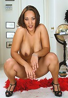 Watch this spicy 30 year old slip out of her red lingerie and spread