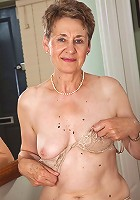 60 year old Dee shows off her shaven mature pussy in this one