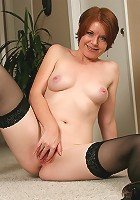 Red headed Ginny slips off her lingerie to reveal a shaved pussy