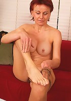Red headed MILF slips on nylons and spreads her small ass