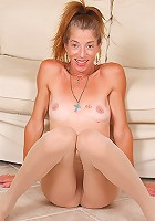 46 year old Courtney peels off a pair of tight nylons
