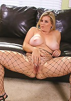 Big and busty Kala in a fishnet body stocking