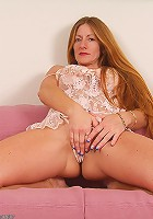 Redheaded MILF Wendy in crotchless lingerie playing