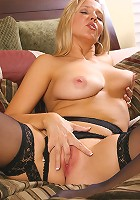 Gorgeous blonde MILF in black lingeries bares all for us