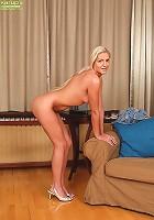 Stunning MILF Kelly White slips jean skirt off hips.