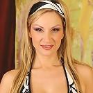 Busty Carol Goldnerova spreads her pussy lips wide open.