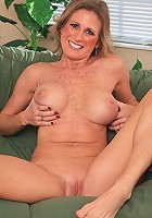 Freckled cougar Jade Jamison exposes her shaved pussy.