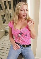Busty blond cougar Lisa toys her horny pussy.