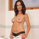 Busty mature cougar Wendy gets her pussy wet in the shower.