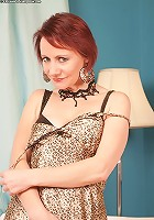 Older redhead Tiffany spreads her pink pussy lips wide open.
