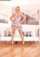 Blonde MILF Rebecca drops pink panties around her ankles!