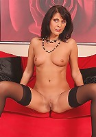 Foxy MILF Anita strips off her black lingerie and fingers her bare snatch.