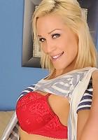 Blonde cougar Jaycie peels off her red lace panties.
