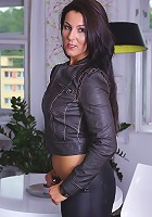 Brunette MILF Valentina Ross peels of black leather hot pant...