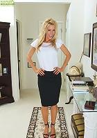 Stunning mature cougar Pamela Rivett exposes big fake tits.