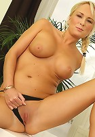 Busty blonde cougar Chloe Deluxe spreads her pussy.