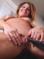 Gorgeous cougar Sky Rodgers drops business skirt to floor.