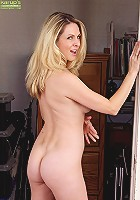 Busty mature babe Angela Attison exposes her ass.