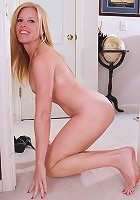 Stunning cougar Monique posing butt naked in the house.