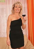 Older babe Janet Darling enjoys wine while fingering herself...