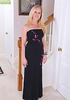 Busty mature Monique slides black dress off her tight body.