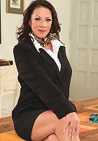 Older office babe Margo Sullivan toys pussy after work.