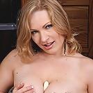 Horny cougar Vicky Vixen masturbating her wet pussy.