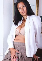 Busty Latin office babe Veronica spreads pink pussy lips.