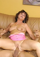 Granny GILF takes a big black dick!