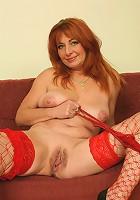 Sexy, Redheaded grandma bones on camera!