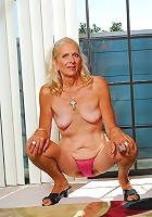 Dressed in a little pair of pink panties April is out to show she still can fuck like an old pro