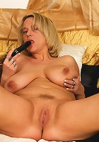 Busty blond MILF gets her big titties fucked and jizzed!