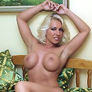 Horny blonde Lana gets completely naked and shows off her body and feet