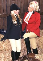 Two stunning girls dressed as jockey enjoy some real leasbian action in the stables