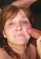 Cumshot lands on her mature face