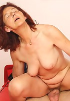 The sensual and sexy mature redhead gets hammered in her old pussy hard by his dick