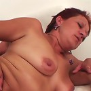 Granny gets a cumshot on her face and her sexy old tits and it feels so warm on her skin