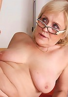 Granny in sexy stockings bends over the table and he jams his cock into her fabulous pussy
