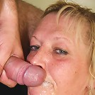Mature blonde slut gets a sticky cumshot on her wicked pretty face and delights in it