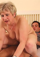 After fucking her pussy hard he pulls out and cums on the granny slut's lower back