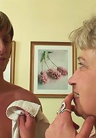Granny bends over on the couch and the young guy fucks her wet pussy from behind real hard
