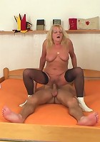 Old blonde babe in stockings makes his dick feel so good he never wants to stop fucking her