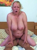 Fat mature bobs on his cock with her mouth and then gets fucked doggy style