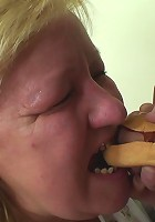 Mature chick makes a hotdog out of his cock and then gets it in her old pussy