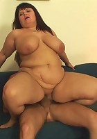 She is a fat mature bitch and she is horny for cock, which is what the young man provides