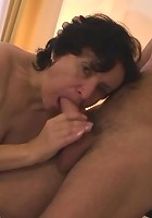 After having sex with this slutty granny babe he cums on her pretty face and she loves it