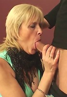 The blonde mature is on the bed letting him do her old pussy all he wants